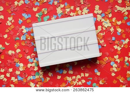 Blank Lightbox Sign On Red Paper Background With Confetti, Party Celebration Concept Flat Lay With C