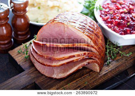 Holiday Glazed Sliced Ham On Dinner Table For Thanksgiving Or Christmas
