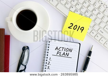 2019 Action Plan Text On Notepad On Top Of White Office Desk