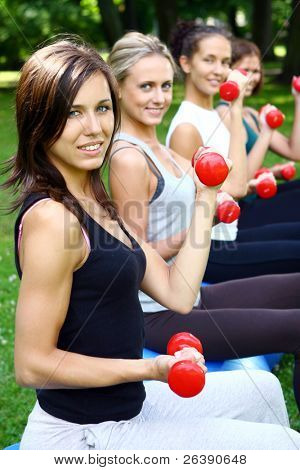 young and attractive people group doing fitness exercises