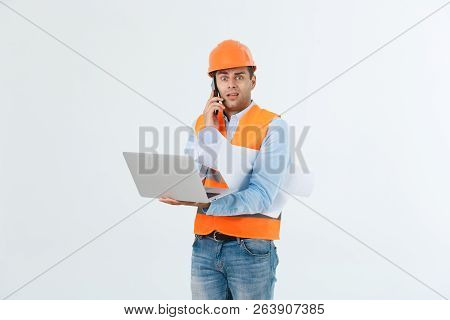 Engineer, Architect, On Busy Face Speaks On Smartphone While Holds Blueprints. Man, Foreman In Helme