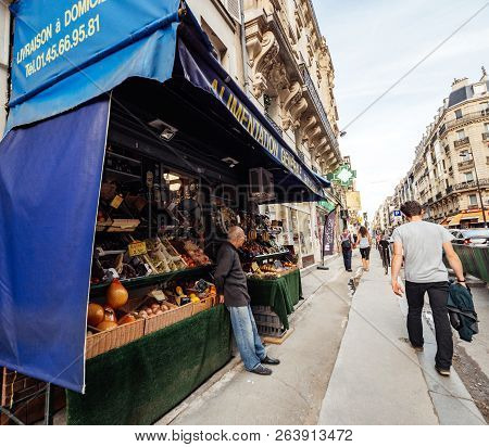 Paris, France - Oct 13, 2018: Middle-eastern Ethnicity Senior Man Looking At The Pedestrians From Hi