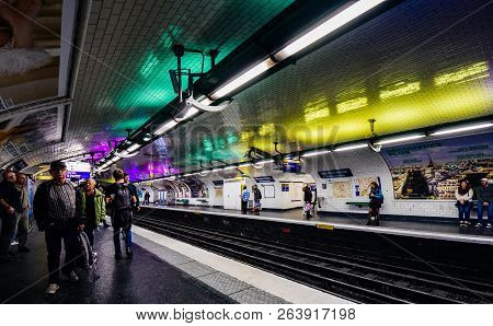 Paris, France - Oct 13, 2018: People Waiting In The Montparnasse Bienvenue Metro Subway Station For