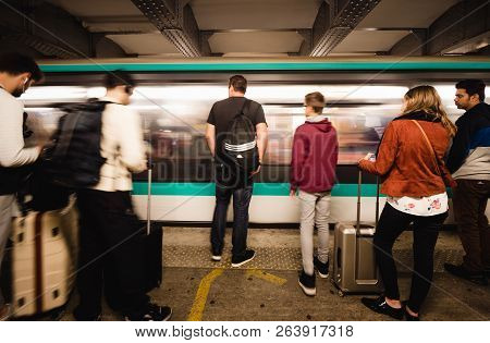 Paris, France - Oct 13, 2018: Fast Train Walking Fast As Commuters Large Crowd Of People Waiting In