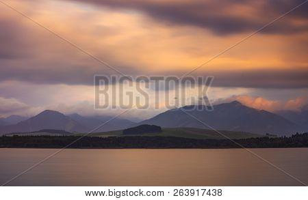 Long Exposure Shot Of Lake, Mountains And Cloudy Sky At Sunset. Liptovska Mara, Slovakia