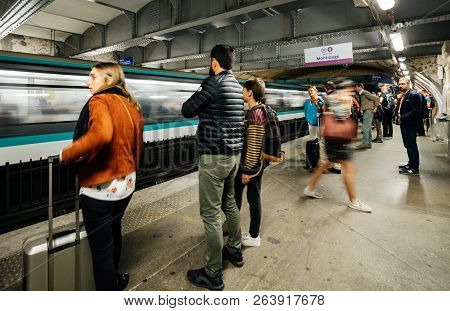 Paris, France - Oct 13, 2018: Side View Of Commuters Large Crowd Of People Waiting In The Montparnas