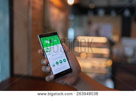 Chiang Mai, Thailand - June 09,2018: Man Holding Huawei With Wechat  On The Screen.wechat Is A Chine