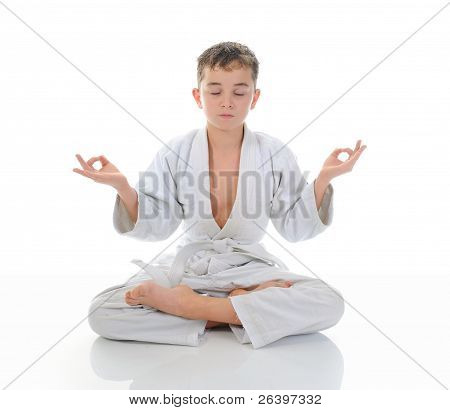 Young boy training karate.