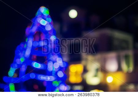 Abstract Blurry Image Of A Blue Christmas Tree In The Old City Center