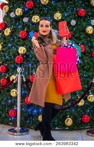 Happy Woman In Shopping. Smiling Woman With Shopping Bags Enjoying In Shopping. Consumerism, Christm