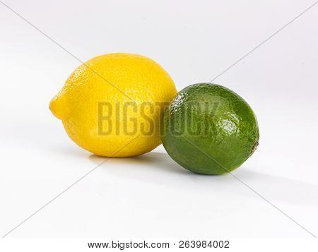 A Single Lemon And Lime On A White Background