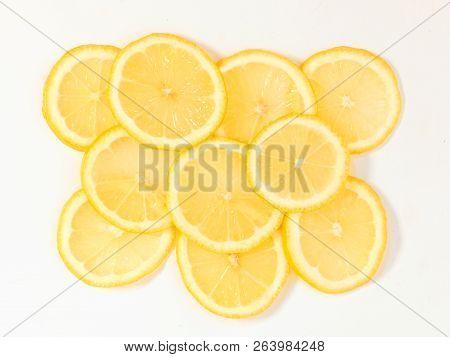 Some Sliced Lemon On A White Background
