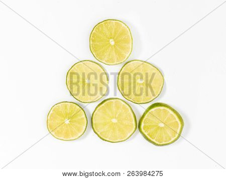 Some Sliced Limes On A White Background