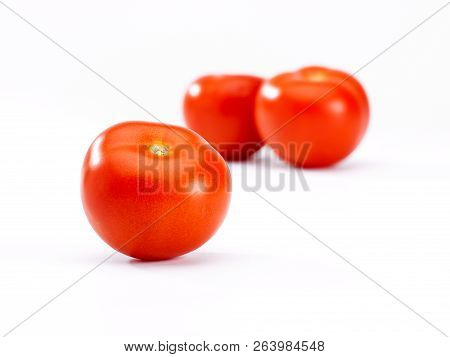 Tomatoes In Close Up On A White Background