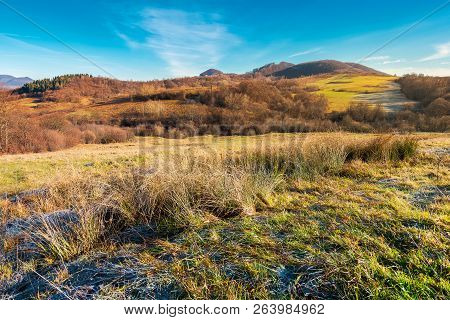 Lovely Autumn Countryside In Mountains. Beautiful Morning Scenery With Hoar On The Grass And Bright