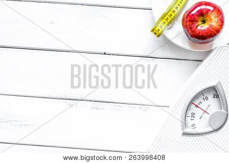 Floor Scale And Apple On Wooden Background Top View