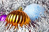 White tinsel and christmas balls (gold,violet, blue) poster