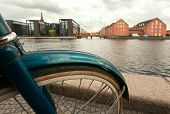 Cityscape with river, old buildings and parked bicycle in Copenhagen, Denmark. Danish capital with cycles, old houses and water chanel. poster
