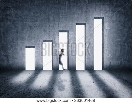 Man Walking Behind A Concrete Wall . Increasing Graph Concept . Opened Doors Increase Earnings Oppor
