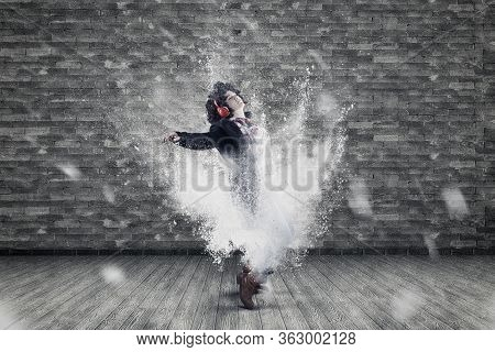 Woman Listening Music On Headphones And Dancing . Powder Explosion Motion Dance .