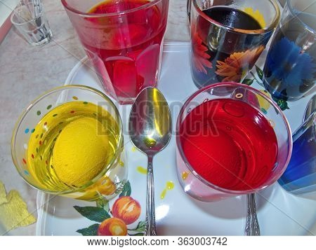Coloring Easter Eggs In Different Colors. Colorful Easter Eggs - Part Of The Passover Meal. Easter (