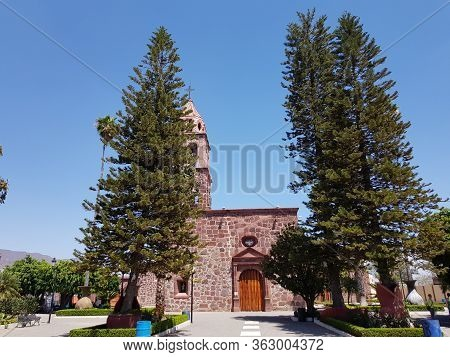 Church Of Jocotepec In The Middle Of Two Trees, Jalisco