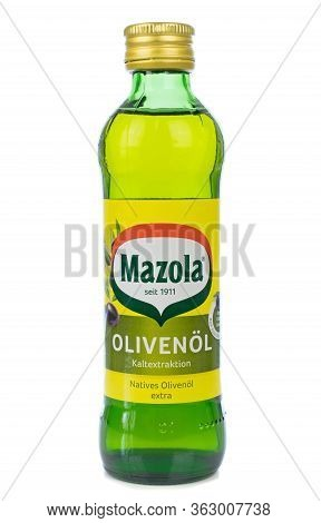 Niedersachsen, Germany April 23, 2020: A Glass Bottle Of Mazola Cooking Olive Oil On A White Backgro