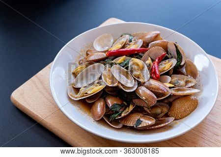 Delicious Stir Fried Clams With Chili Paste On White Plate.thai Food.