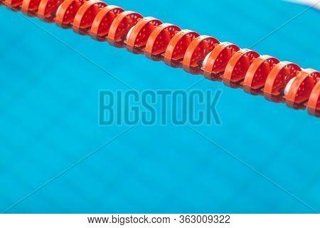 Close Up Of Swim Lane In Swimming Pool. Plastic Swimming Pool Floating Wave-breaking Lane