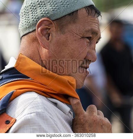 Osh, Kyrgyzstan - June 30, 2019: Man With Hat On The Livestock Market In Osh, Kyrgyzstan.