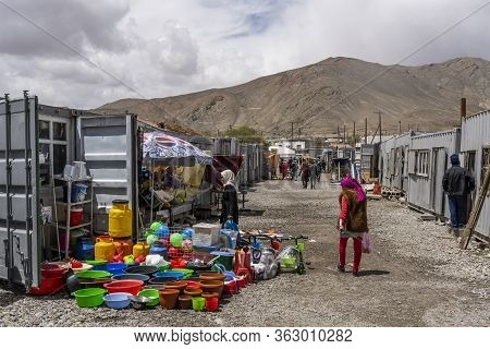 Murghab, Tajikistan - June 25, 2019: The Market With Container Shops And  People In Murghab, Tajikis