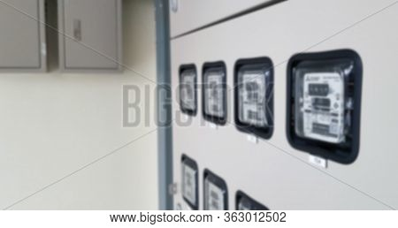 Blurred The Electric Power Meter Measuring Power Usage. Watt Hour Electric Meter Measurement Tool Wi