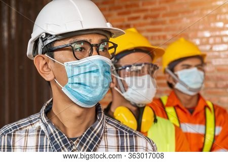 [construction Teamwork ] Team Of Construction Engineers And Three Architects Are Ready To Wear Medic