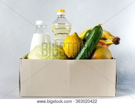 Food Delivery Box Donation Food Donation Concept. Donation Box With Vegetables, Fruits And Other Foo