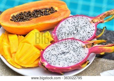 Plate Of Fruits By Pool. Plate Of Fruits. Mango. Papaya. Dragon Fruit. Thai Fruits On The Plate. Hea