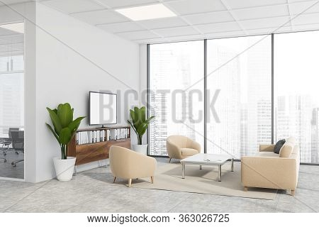 Corner Of Modern Company Waiting Room With White Walls, Tiled Floor, Comfortable Beige Sofa And Armc