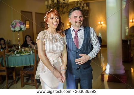 Young Beautiful Couple Smiling Happy And Confident Getting Married. Standing With Smile On Face At R
