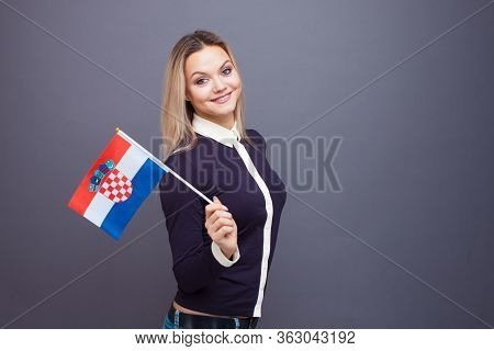 Immigration And The Study Of Foreign Languages, Concept. A Young Smiling Woman With A Croatia Flag I