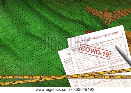 Zambia Flag And Health Insurance Claim Form With Covid-19 Stamp. Coronavirus Or 2019-ncov Virus Conc