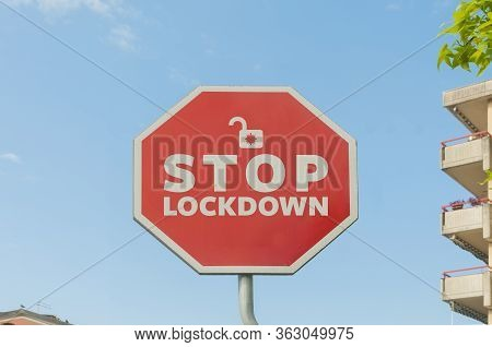 Stop Lockdown Concept: A Stop Street Sign With The Text Stop Lockdown With A Blue Sky On The Backgro