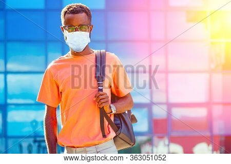 Handsome Trendy African Americans Nerd Male With Glasses In Stylish Clothes Colorful T-shirt With A