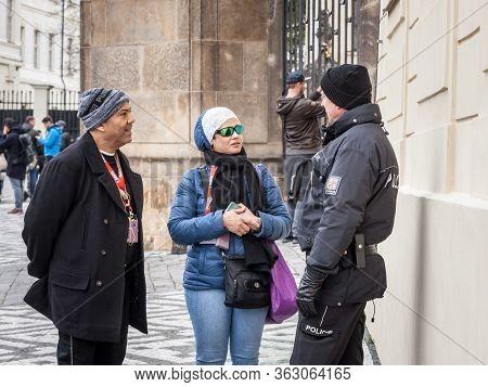 Prague, Czechia - November 2, 2019: Czech Police Officer Discussing & Helping Tourists In Prague Cen