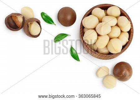Macadamia Nuts In Wooden Bowl Isolated On White Background With Clipping Path And Full Depth Of Fiel