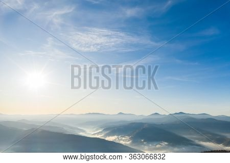 Shining sun at clear blue sky. Beautiful natural wallpaper. Blue sky background in the fresh sunny day. Concept of the ecology. Template textured sky background. Beauty of earth.