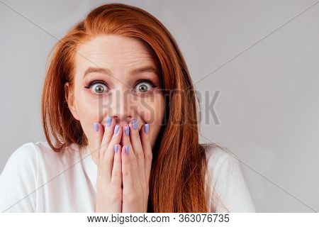 Redhair Ginger Woman In White Cotton T-shirt Fingers Crossed Wishing The Best In Studio Gray Backgro