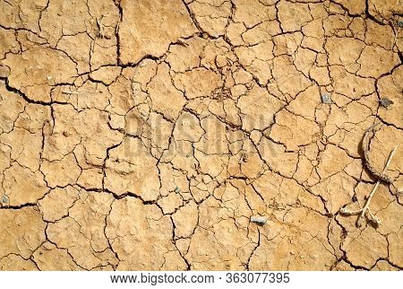 Cracked Earth, Cracked Soil. Texture Of Grungy Dry Cracking Parched Earth. Global Warming Effect. Tr