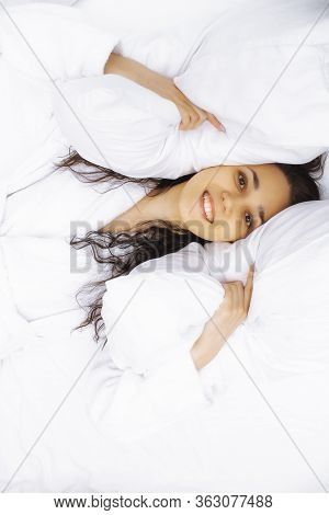 Girl Lies In Soft Pillows Top View. Female Portrait On Orthopedic Pillows. Woman With Pillow.