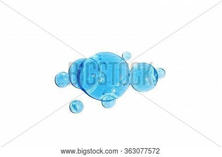 Water Texture With Bubbles Hyaluronic Acid Cosmetic Gel. Gel Texture With Bubbles On A Blue Backgrou