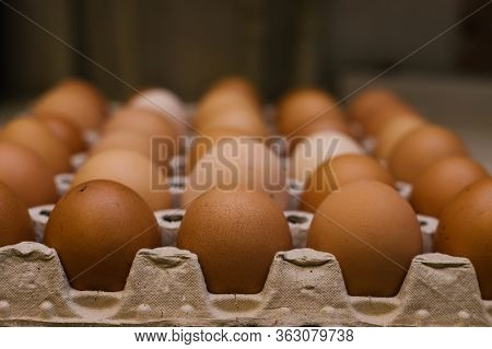 Homemade Chicken Eggs. Eggs In A Cardboard Container For Transportation.raw Egg. Delicious And Healt