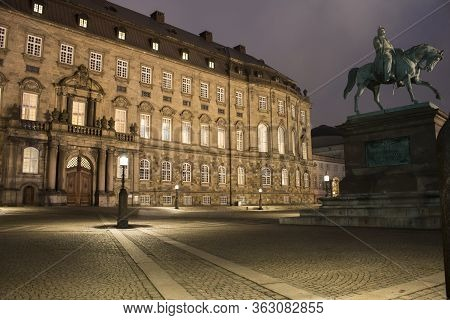 Christiansborg Palace Facade And Frederik Vii Statue At Night